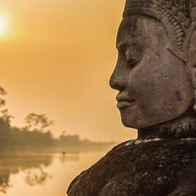 Buddha is shown over a body of water in Angkor Wat, where Projects Abroad volunteers visit and educate themselves on Khmer History